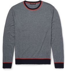 Michael Kors' striped sweater is knitted with cotton and brushed to create a soft, cosy texture. Cut in a slightly fitted shape, this design has a trim profile whether worn solo or layered. Its orange detailing adds a contemporary touch to the classic nautical styling. Pair yours with indigo or black denim.