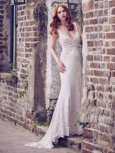 This boho-inspired wedding dress features allover lace motifs in a sheath silhouette, completing the nude and illusion bodice, V-neckline, illusion straps, and illusion V-back. Lined with Inessa Jersey for a luxe fit. Finished with covered buttons over zipper closure. Detachable tulle overskirt with textured ribbon waistband sold separately.