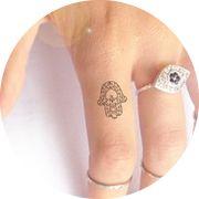 Fatima hand or Hamsa tattoo. Symbol of protection
