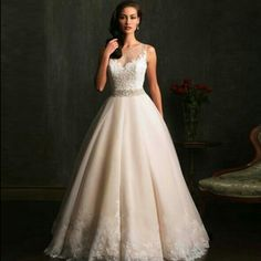 Women's Stunning White Round Neck Solid Lace Floor-Length Wedding Dresshas Stylish O-neck, sleeveless with Stylish Lace Top with checked detail on the sides, stylish back with strips &checked panel detail on the sides, flared hem, has an attached lining.