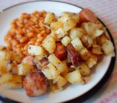 """Oven Sausage & Potatoes(4)..1pkg smoke sausage(peel/slice rounds),1lrg onion-peel/chop,5 lrg potatoes-peel/chop 1/2""""cubes,olive oil,sea salt,freshly ground black pepper,sweet paprika,dried thyme,grated cheddar.. Preheat 400*.Line lrg baking pan (w/sides) w/several foil sheets;coat w/oil.Toss,w/hands to coat, sausage+onions+potatoes w/bit of oil & season w/salt+pepper+paprika+dried thyme. Spread on pan evenly. Roast 45min-1hr (stir every 15min) golden/tender. OVEN OFF. Top w/cheese. Oven to…"""