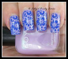 http://www.bettysbeautybombs.com/2015/02/17/hawaiian-blue-flowers-nail-art/ / Zoya Leslie Hawaiian flowers nail art