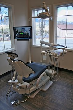 A-Dec dental chair and LED operatory light. White Dental Studio is Southern Oregon's first certified eco-dentistry practice, located in Ashland, OR. Dr. Brandon White, Dentist, EDA, Eco-Dentistry Association, Green Dentistry