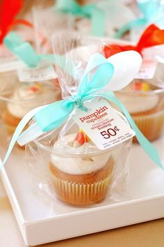 Smartness! Use 9oz. plastic cups wrapped in treat bags to individually package cupcakes.