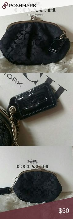 """Authentic Black Vintage Coach Signature Coin Purse Authentic Vintage Coach Signature Coin Purse With Kiss-Lock Closure. Black With Silver Hardware. Coach Hangtag. Fabric With Leather Trim. Fabric Black Lining. 661100 5 1/4""""(L)X 3 3/4""""(H) I Am The Only Owner. Hardly Ever Used. In New Condition! No Flaws! Clean As A Whistle! Super Tough To Find!  Same Or Next Day Shipping!! Thank You! Coach Bags Clutches & Wristlets"""