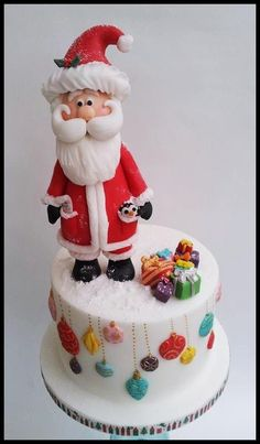 weihnachten torte Like the idea of just ornaments hanging down! Santa Cake by Time for Tiffin Christmas Themed Cake, Christmas Cake Decorations, Christmas Cupcakes, Christmas Sweets, Christmas Cooking, Holiday Cakes, Noel Christmas, Christmas Goodies, Xmas Cakes