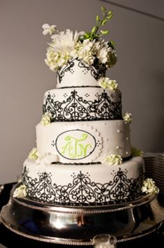 Lace Motif in Black on White Cake with floral accents