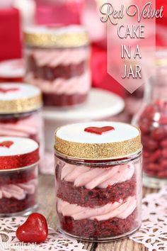Red Velvet Cake In A Jar - layers of red velvet cake and strawberry rose cream cheese frosting in a jar, perfect for gift-giving!   From SugarHero.com