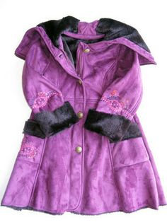 Catimini Girls Purple Faux Sherling Coat A passion for purple,  winter coat by Catamini. Little girls and girls sizes 4 - 12.           Fuchsia and pink embroidered decorative flowers on sleeves and pockets,     Attached hood with zipper at center, opens as a collar. NOW ON SALE