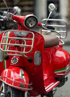 An adorable scooter we found while wandering the streets of Rome, Italy. #theworldexplored #italy #vespa #red #scooter #rome