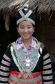 Traditional Hmong Women's outfit taken at New Years.Hmong New Year is usually at the end of November and December. During the New Year festival Hmong people enjoy food,dance,music, bull fights and other cultural traditions.