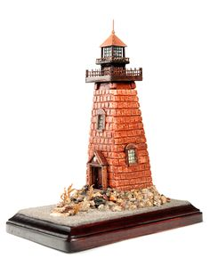 One of a kind, original De Vazquez lighthouse. The Rhody Light is made with authentic Rhode Island coastal stones and sand. This artwork is copyrighted. seasideartistry.webs.com