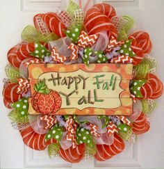 """Happy Fall Y'all Handmade Deco Mesh Harvest Wreath. Full! New! Premium! Handmade Autumn Deco Mesh Wreath. A beautiful, large wood sign with glittering """"Happy Fall Y'all"""" wording rests on a bed of pure white deco mesh. The sign is orange with yellow dots. Bright green ribbons with white dots and orange and white chevron ribbons surround the center. Beautiful orange deco mesh with white stripes is used for the outer wreath along with glittering bright green mesh flutes and soft white…"""