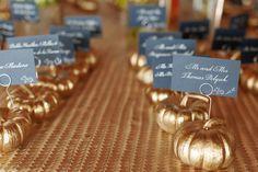 20 Pumpkin Decor Ideas: Gilded, metallic gold mini pumpkins as escort card holders {Elisabeth Millay Photography}