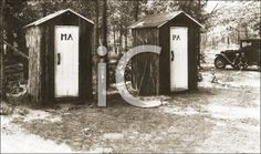 iCLIPART - Royalty Free Photo of Two Outhouses