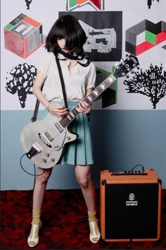 Finally a fully dressed girl with a guitar who is not only posing