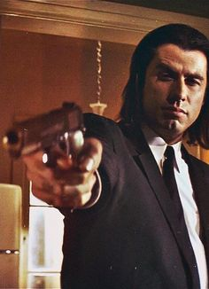 John Travolta as Vincent Vega in Pulp Fiction. A film directed by Quentin Tarantino. Iconic Movies, Classic Movies, Good Movies, Pulp Fiction Zitate, Quentin Tarantino Films, Tarantino Filmography, Crime Film, Actrices Sexy, Movie Shots
