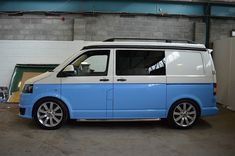 Unique VW Transporter T5 two tone camper conversion. Includes VW Sport-line front & rear spoilers, Check out our latest VW Transporter T5 Campervan Conversions on our Facebook page