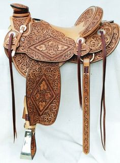 Gorgeous tooled leather saddle by Troy West Saddles. Leather Art, Saddle Leather, Leather Tooling, Leather Carving, Tooled Leather, Western Horse Tack, Western Saddles, Horse Gear, Horse Tips