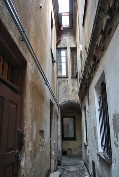 This is a narrowest street in Vilnius old town, which is a part of UNESCO World Heritage since 1994, Lithuania Copyright: Ko Ropo
