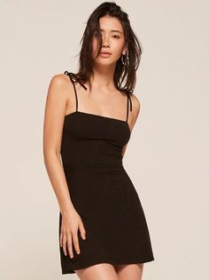 Easy. This is a mini length, fit and flare dress with a straight neckline and strap ties.