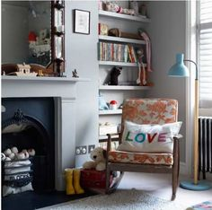 Grey children's bedroom with book shelves in alcove. Traditional with a contemporary colour scheme. Nice.