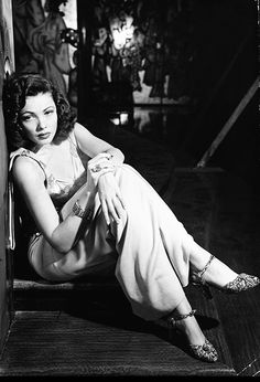 Gene Tierney sits on the set of her new movie, The Shanghai Gesture (1941). Photo by Peter Stackpole