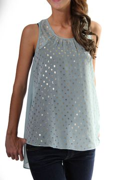 This gorgeous sheer top in Misty Blue by Ya features gold foil polka dot detailing, as well as a hi-low hemline. Shown here with a black camisole. (Not Included)Material Content: 75% Silk, 25% PolyesterCare Instructions: Hand Wash