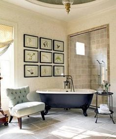 tub + shower + wall prints (oh and that little peek of what looks to be an awesome ceiling detail)