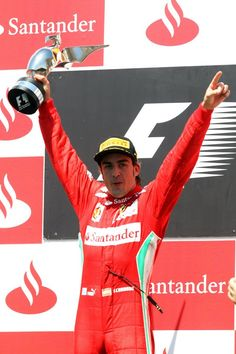 Fernando Alonso celebrating after the 2012 European GP