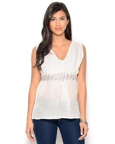 """Size: Papillon Metallic Lace-Strap Blouse Size M original brand name Papillon item Apparel product type Blouse made in INDIA Care Instructions hand wash Condition brand new Fit classic fit Gender women Material 100% cotton, lining: 100% cotton Neck Type v-neck Sleeves sleeveless size M"""