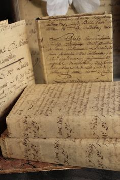 Cover old books with lovely script paper/ This would look so pretty in the ofc. or in my guest bedroom.