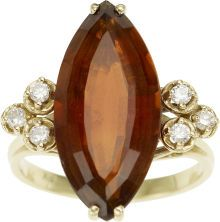 The ring features a marquise-shaped Madeira citrine measuring 21.84 x 10.00 x 6.60 mm and weighing approximately 6.50 carats, enhanced by full-cut diamonds weighing a total of approximately 0.18 carat, set in 18k gold. Gross weight 5.03 grams..