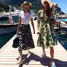 Straw hat, patterned midi skirt and a simple tee or a patterned midi dress with a full skirt paired with sneakers.