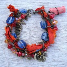 Orange, Blue, and Red Multi Strand Artisan Bracelet by Cindy Cima Edwards