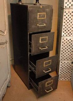 An oldfashioned filing cabinet reminds me of my dad.  Four drawer metal filing cabinet c.1940 with Paris makers mark