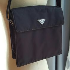 """Authentic 90's PRADA crossbody bag Brand new 90's nylon dark brown Prada bag, certificates included. Bag measures 8""""x8"""" expands about 2 inches. Magnetic closure. Zipper compartment inside.  Compartment on outside of bag, no closure for this outside compartment.  Maximum length for strap is 42"""", shortest length for strap is 22"""". No trades please. Prada Bags Crossbody Bags"""