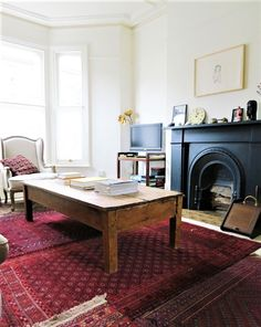 Vintage interior decor, eclectic living room, red rug, oriental rugs, oriental rug, fireplace living room, wooden table