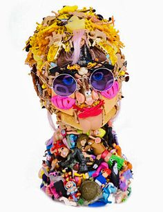 This is Freya Jobbins (Yoko Ono). The Australian artist makes portraits assembled from discarded toys and plastic parts.