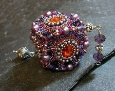 Beaded pendant by Mariposa (Martina Nagele), from a Laura McCabe workshop/kit; the rivoli is light siam brandy
