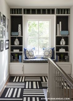 navy and white interior decorating staircase landing window seat