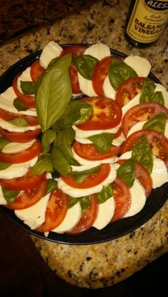 Capresi Salad. Fresh tomato, fresh mozzarella and home grown sweet basil. Topped with balsamic vinegar. Yum!