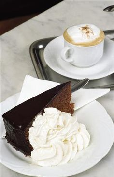 Sachertorte with a coffee at Café Sacher. This stylish coffee house is the original home of the Sachertorte chocolate cake. Photo courtesy of WienTourismus/Peter Koller