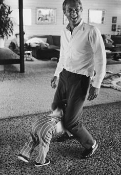John Dominis—Time & Life Pictures/Getty Images Steve McQueen, so often cool and stoic onscreen, laughs while playing with his son, future B-movie actor Chad McQueen, at home in Hollywood in 1963.