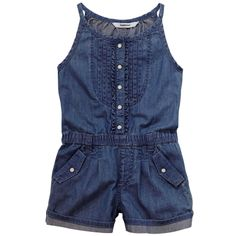 Short jumpsuit made of dark blue chambray fabric. Shoulder straps. Snap buttons on the chest. Elasticated waistband. Side pockets. Belt loops. - 42,00 €