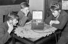 Listening to radio was a new experience in the early 1920s, and boys were ardent enthusiasts of the emerging technology.  Bettmann/Corbis