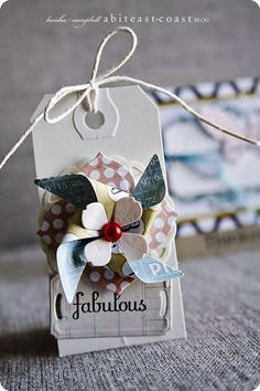 Gift Tag by A Bit East Coast.  No better word to describe this tag but FABULOUS! The tag is a gift in itself. Find cardstocks to replicate this pretty tag at www.cardstockshop.com.