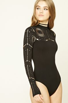 A stretch-knit bodysuit featuring mesh panels and cutouts, high neckline, long sleeves, and a snap-button closure.