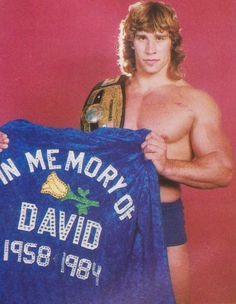 Kerry Von Erich: NWA World Heavyweight Champion [1984] Kerry is posing here with the custom robe he wore to the ring the night he won the NWA title from Ric Flair at Texas Stadium on May 6th, 1984. The robe was a tribute to his late brother David who had died months earlier on a tour with All Japan Pro Wrestling. The exact cause of death of David Von Erich isn't known, but he was penciled in to win the title himself from Flair at the show at Texas Stadium, a victory that ended up given ...
