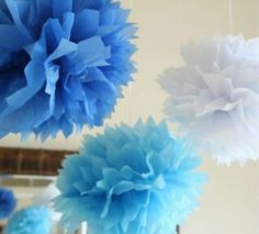 Blue pom poms for grad party